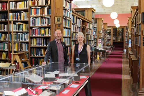 College Librarian James Clements and College Archivist Patricia McGuire waiting to welcome visitors