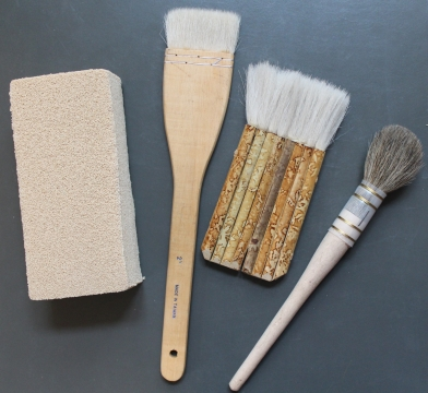 Some of the brushes and smoke sponge used for cleaning rare books.